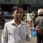 Un thailandais avec une canette d'Est